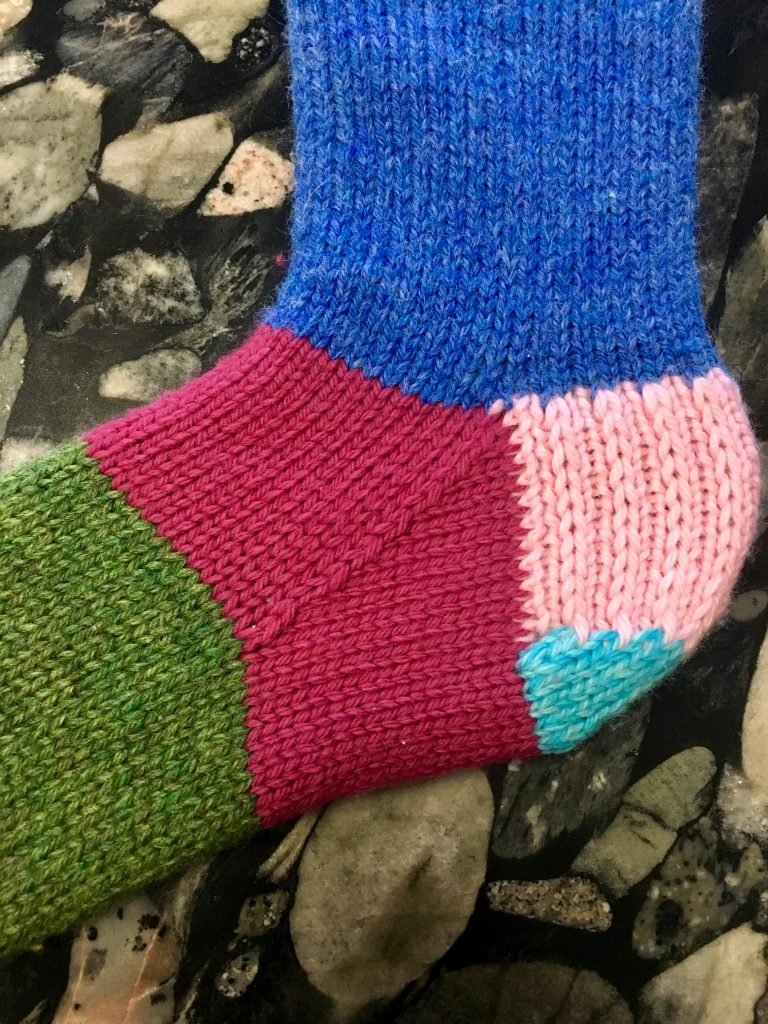 knitting gussets add stretch to fabric and is good for areas that are typically tight such as across the arch of a sock or the underarms of a sweater.  #knitting #gussets #knittinggussets #handknitsweater #slowfashion #makeclothes #handknit #knitter #handknitsocks