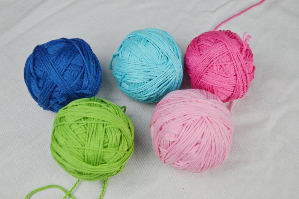 Flowers in the Snow Blanket #flowersinthesnowblanket #squares #circles #grannysquares #tourquiose #green #blue #pink #furls #brownsheepcompany #cottonfleece #crochet #FlowersintheSnow